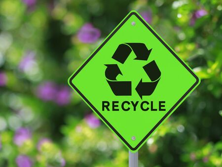 recycle symbol: A road sign on recycling with a nature background