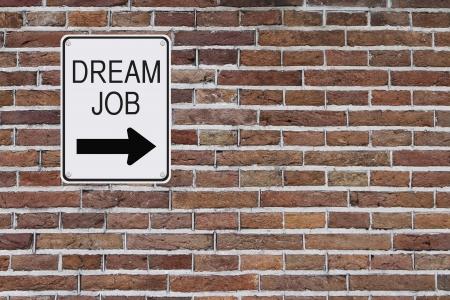 Dream Job sign mounted on a brick wall  photo