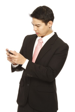 Young man in business attire using a mobile phone  photo