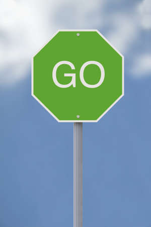 proceed: A conceptual Go sign against a sky background  Stock Photo