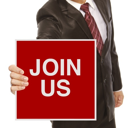 A man in business attire holding a recruitment signboard Reklamní fotografie