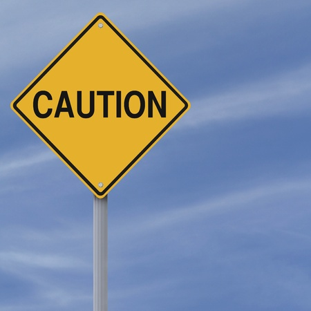 A warning sign against a blue sky background  Stock Photo