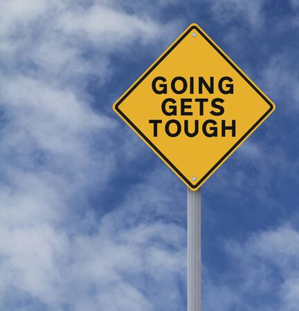 tough times: Conceptual road sign warning of tough times ahead