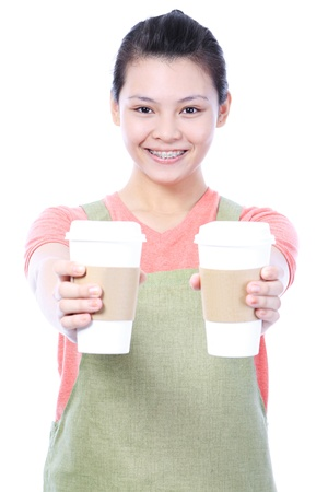 A young barista serving hot drinks in disposable cups  Stockfoto