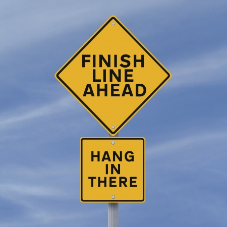 A road sign announcing the finish line coming up