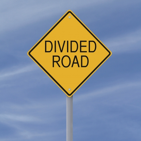 divided: A road sign indicating a Divided Road  Stock Photo
