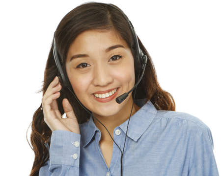 A young smiling woman wearing a headset (isolated on white)  photo