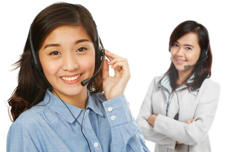 Two young women wearing headsets (on white background) Stock Photo - 19980942