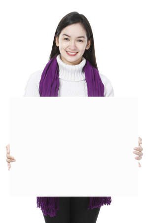 Young woman holding blank message photo