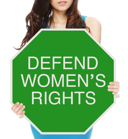 uphold: A woman holding a conceptual road sign promoting women s rights