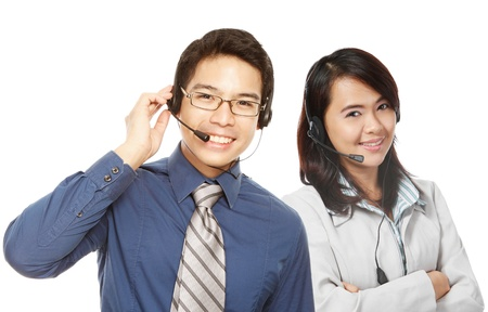 call center people in isolated: A smiling man and woman wearing headsets