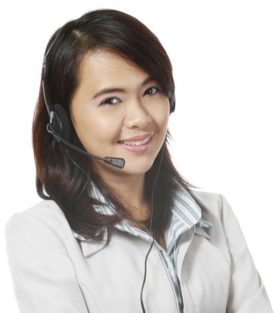 call center agent: Young woman wearing a headset