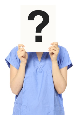 scrub: A woman in medical scrubs holding a signboard with a question mark
