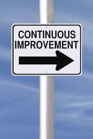 continuous: A modified one way street sign on Continuous Improvement  Stock Photo