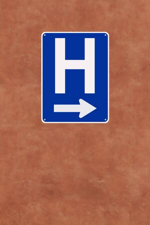 A hospital sign mounted on a wall  photo