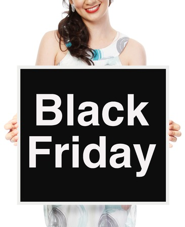 A woman holding a Black Friday sale signboard  Stockfoto