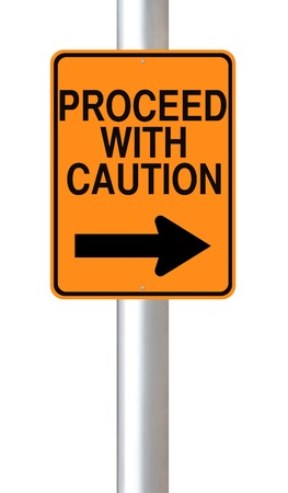 A modified one way road sign indicating Proceed with Caution  Stock Photo