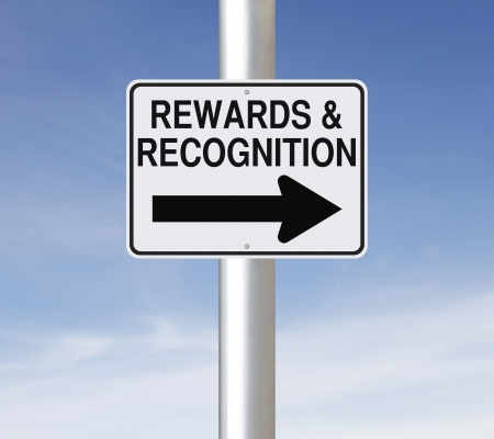 A modified one way road sign on Rewards and Recognition  Stock Photo