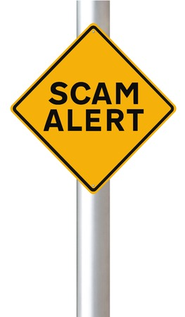 A conceptual road sign warning of a scam alert  Stock Photo - 23989148