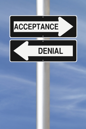 Modified one way street signs indicating acceptance and denial