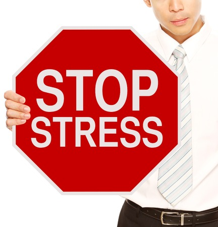 A man holding a stop sign indicating Stop Stress  photo