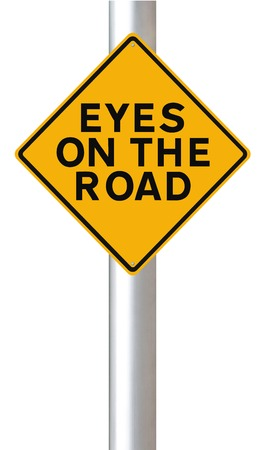 drive safely: Road safety sign indicating Eyes on the Road