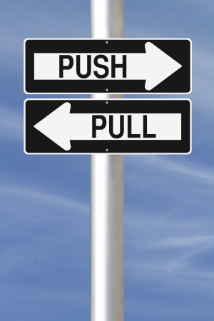 Modified one way street signs indicating Push and Pull