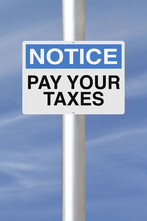 A notice sign with a tax payment reminder  photo