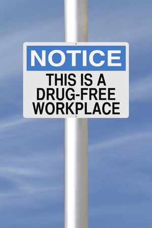 A notice sign announcing a drug-free workplace  Stock Photo