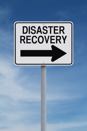 A modified one way road sign indicating Disaster Recovery