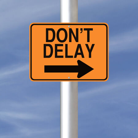 A road sign indicating Don t Delay