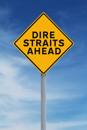 dire: A modified road sign warning of difficult times ahead