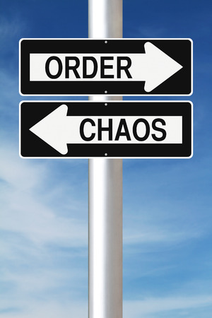 order chaos: Modified one way street signs indicating Order and Chaos