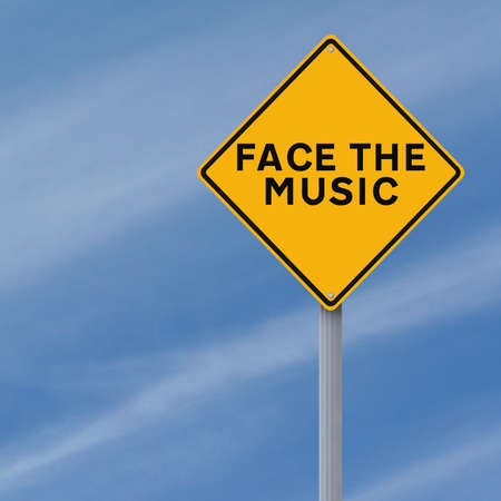 A modified road sign indicating Face the Music  photo