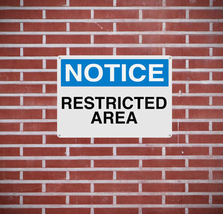 restricted: A warning sign indicating Restricted Area  Stock Photo