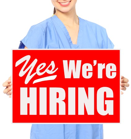 A medical person holding a recruitment sign  photo