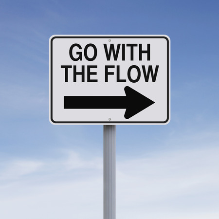 A modified one way sign indicating Go With The Flow  Stockfoto