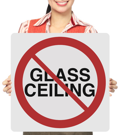 glass ceiling: A woman holding a poster indicating Glass ceiling not allowed