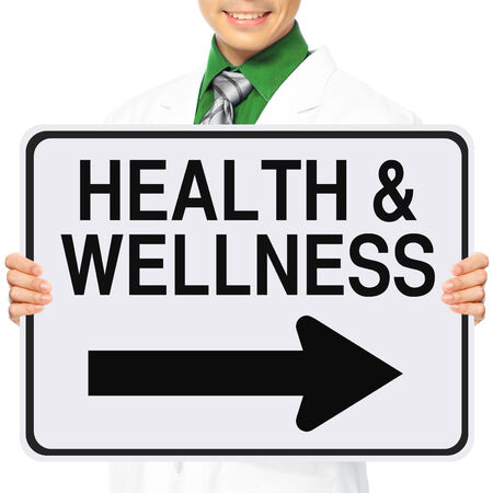 A medical person holding a modified one way sign indicating Health and Wellness photo