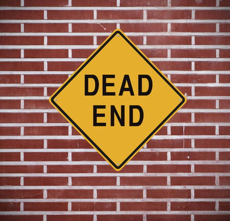 end of road: Dead end sign mounted on a wall