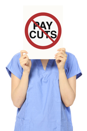 pay cuts: A woman holding a sign against pay cuts Stock Photo