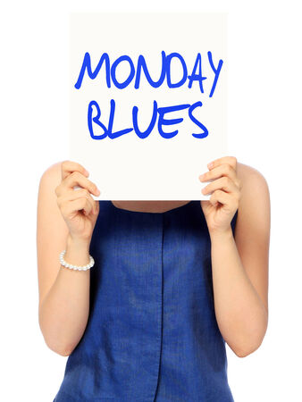 A woman showing a poster indicating Monday Blues