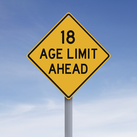 eighteen: A modified speed limit sign indicating an age limit of eighteen Stock Photo