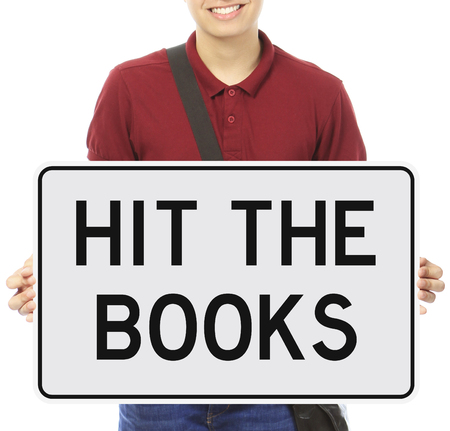 coed: A young man holding a sign indicating Hit the Books
