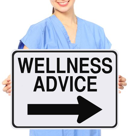 one way sign: A medical person holding a modified one way sign indicating Wellness Advice Stock Photo