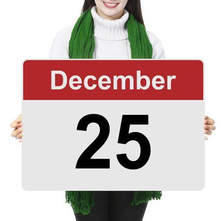 diciembre: Una mujer que sostiene un cartel que indica 25 de diciembre Foto de archivo