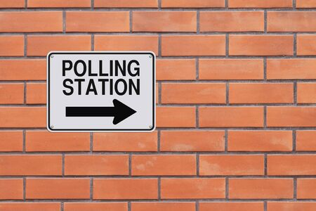 one way sign: A modified one way sign indicating Polling Station Stock Photo
