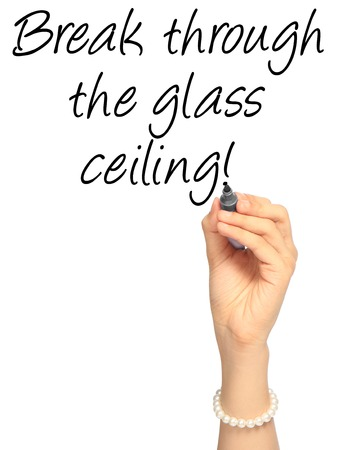 ceiling: A hand writing an idiom on glass ceiling Stock Photo