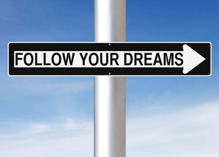A modified one way street sign indicating Follow Your Dreams Stock Photo