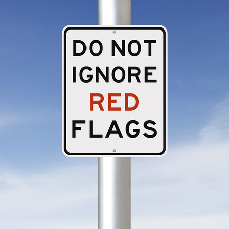 A modified sign on Red Flags Foto de archivo
